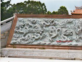 九龙壁浮雕壁画代表威严和祥瑞的石雕艺术品
